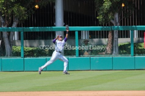 Caleb Brown lunges to catch a liner to RF.