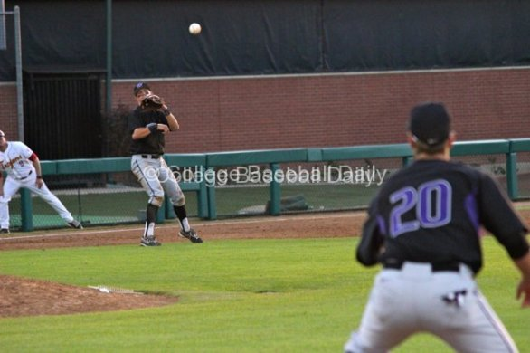 Jacob Lamb watches his throw to first.