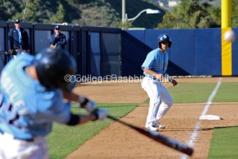 Austin Bailey watches Chris Woolley hit a sac fly.