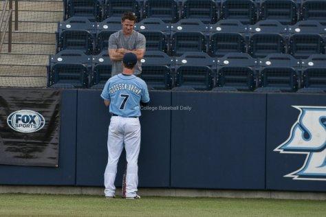 Josh Goosen- Brown talks with his former teammate Kyle Attl