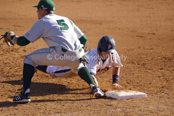 Aaron Brown dives back into first base.