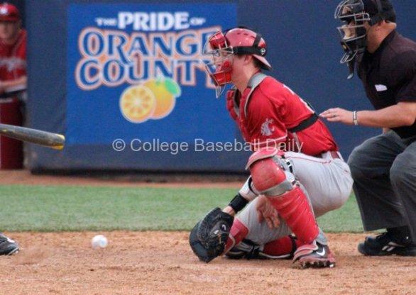 Collin Slaybaugh blocks a ball in the dirt.