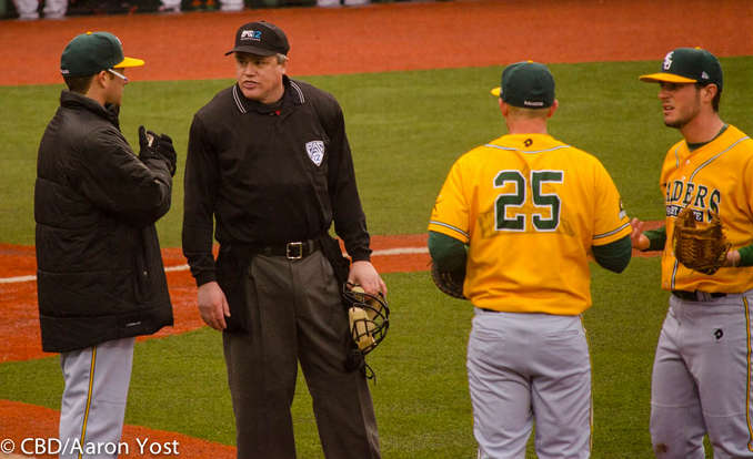 WSU coach Greg Lovelady asks for an explanation on a fair call on the first base line from plate umpire Mike Whitty.