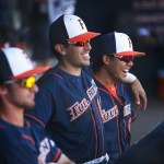 Josh Vargas and Hank LaForte share a laugh in the Titans dugout.