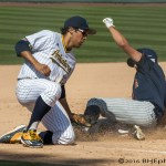 Ruben Cardenas steals 3rd for the Titans in the 9th. Photo by David Cohen, BHEphotos