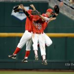 Jun 22, 2016; Omaha, NE, USA; Arizona Wildcats outfielder Jared Oliva (42) and outfielder Justin Behnke (4) and outfielder Zach Gibbons (23) celebrate the win against the UC Santa Barbara Gauchos in the 2016 College World Series at TD Ameritrade Park. Arizona defeated UC Santa Barbara 3-0. Mandatory Credit: Steven Branscombe-USA TODAY Sports