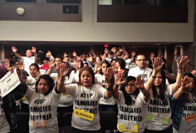 Immigrant rights activists pray during the hearing