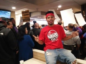 Isaiah Mitchelle, 19, poses for a photo amid early morning protests at a McDonalds in San Francisco. Isaiah works at Jack-In-the-Box for $9 an hour. Photo Credit: Mark Ortiz