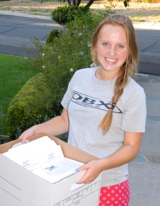 Volunteer Olivia with CC4C Info Packets