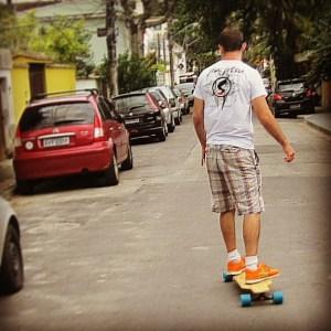 Torryn riding his Bossa Boards longboard in Rio