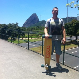Connection Rio founder and BJJ black belt Dennis Asche with his Bossa Board