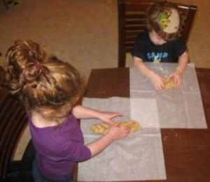 Reader Kate's kids shaping challah dough