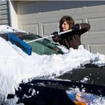 Telescoping Snow Broom shortens your chore time