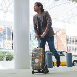 Steve Aoki Micro Kickboard Carry-On Luggage Scooter sports a Bluetooth speaker