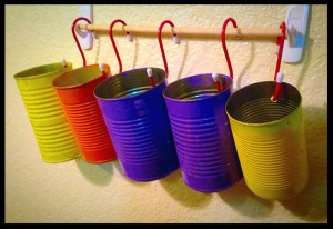 Colored tin cans on S-hooks