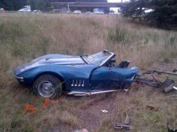 The driver of Corvette died and her passenger is in critical condition after crashing on I-5 in Everett Friday afternoon following what the Washington State Patrol calls a racing incident. (WSP via Twitter)