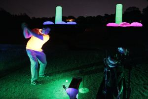 The cosmic driving range night golf experience