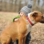 happy-baby-boy-hugs-dog-friendship-1080P-wallpaper-middle-size
