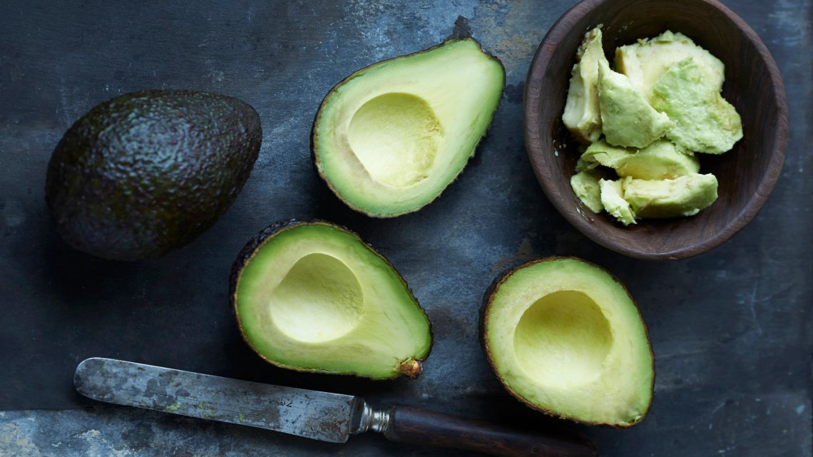 Sliced, mashed and whole avocado