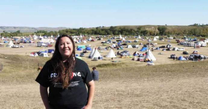 Kandi Mossett on a hill overlooking the Oceti Sakowin Camp. (Photo: Sarah Jaffe for BillMoyers.com)