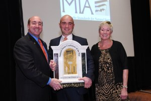 Stefano Follega accepts the Craftsman of the Year Award from MIA