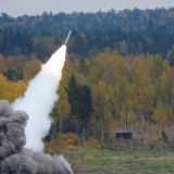 """Russia -- A BM-30 Smerch (Tornado) heavy multiple rocket launcher fires at the Ninth International Exhibition of Arms, Military Equipment and Ammunition """"Russia Arms Expo 2013"""" in Nizhny Tagil, September 25, 2013"""