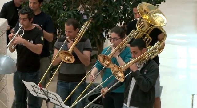 Flashmob Orchestra Strikes Wows Hospital Audience Guerrilla Marketing Photo