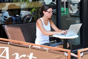 stock woman using laptop