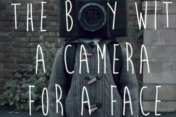 TheBoywithaCameraforaFace_COV