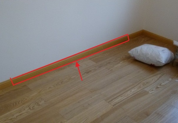 wood style kick shoe line in 2nd room