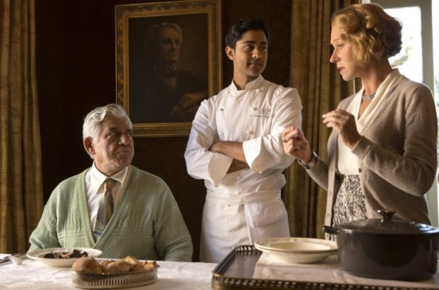 """This image released by DreamWorks II shows, from left, Om Puri, Manish Dayal and Helen Mirren in a scene from """"The Hundred-Foot Journey."""" (AP Photo/François Duhamel, DreamWorks II)"""
