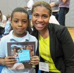 Nanzie's Reading Buddy enjoys hearing her read about baseball greats.