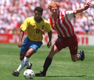 4 JUL 1994: ROMARIO OF BRAZIL SURGES PAST ALEXI LALAS OF USA DURING THE 1994 WORLD CUP FINALS SECOND ROUND MATCH AT STANFORD STADIUM IN PALO ALTO, CALIFORNIA. Mandatory Credit: Chris Cole/ALLSPORT