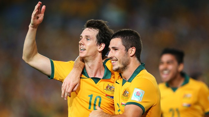 SYDNEY, AUSTRALIA - JANUARY 13: Robbie Kruse of Australia celebrates with team mate Mathew Leckie after scoring a goal during the 2015 Asian Cup match between Oman and Australia at ANZ Stadium on January 13, 2015 in Sydney, Australia. (Photo by Brendon Thorne/Getty Images)