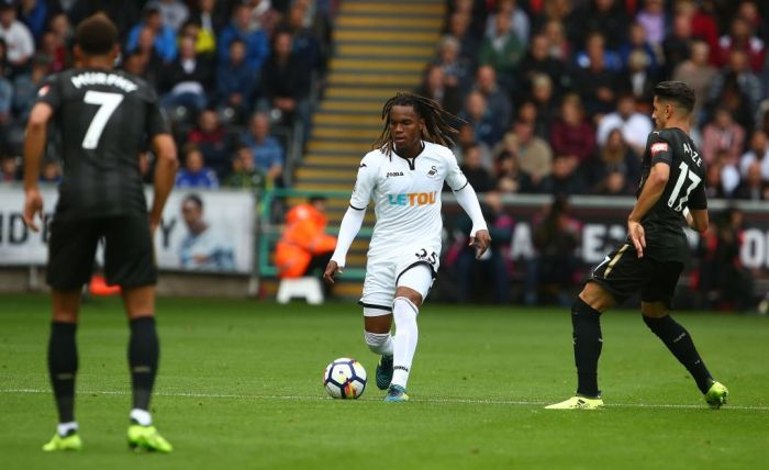 Swansea City's Portuguese midfielder Renato Sanches (C) controls the ball during the English Premier League football match between Swansea City and Newcastle United at The Liberty Stadium in Swansea, south Wales on September 10, 2017. / AFP PHOTO / Geoff CADDICK / RESTRICTED TO EDITORIAL USE. No use with unauthorized audio, video, data, fixture lists, club/league logos or 'live' services. Online in-match use limited to 75 images, no video emulation. No use in betting, games or single club/league/player publications. / (Photo credit should read GEOFF CADDICK/AFP/Getty Images)