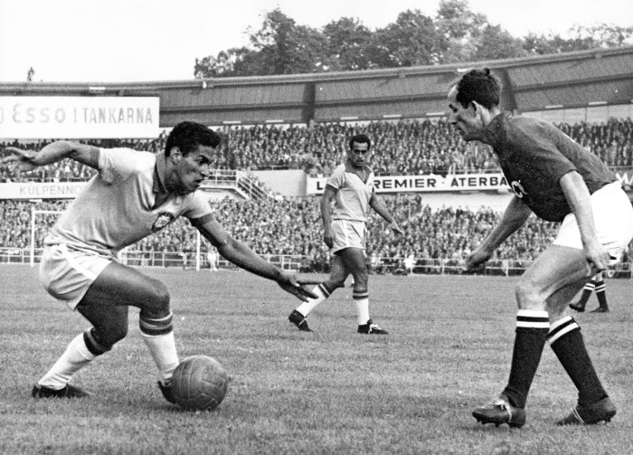 Brazil's Garrincha, dribbles to past an unidentified Soviet Union player