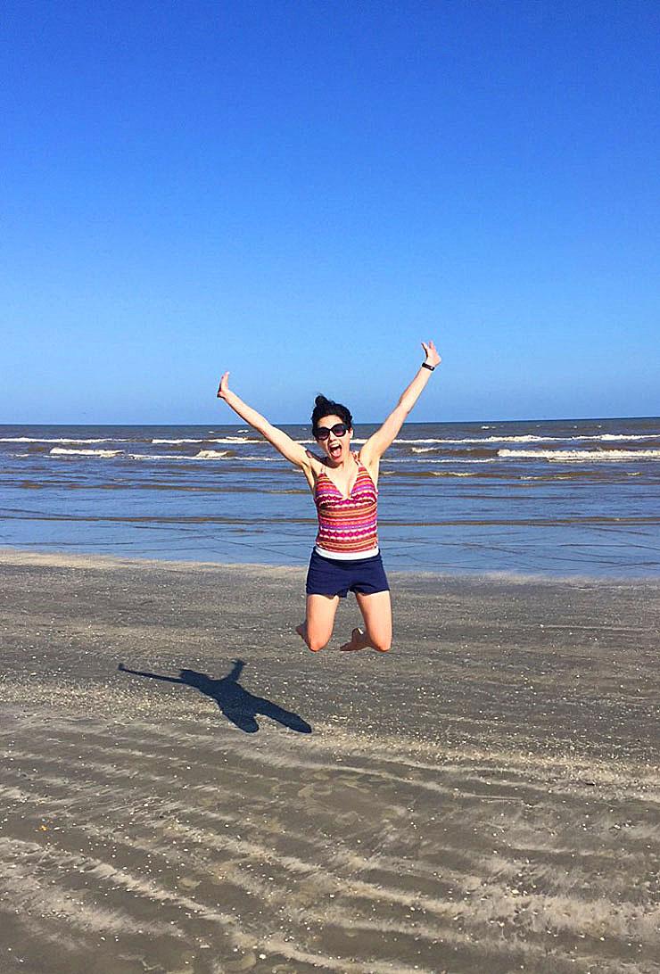 Jumping for Joy at Galveston Beach   www.cupcakesandthecosmos.com