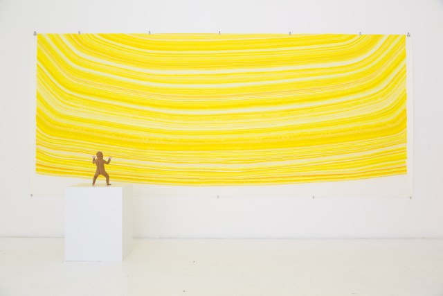 """Looking at the Sun (2012), color pencil on paper, magic sculpt, felt, metal, clay; 96 x 168 x 72""""/figure size 9 x 3 x 2"""". Courtesy of Gallery Diet, Miami, Florida."""