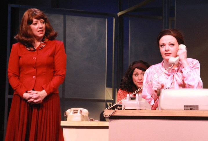 Violet Newstead (Annie Edgerton), left, is concerned as new employee Judy Bernly (Sarah Hund) frantically tries to answer the phone in 9 to 5, The Musical.