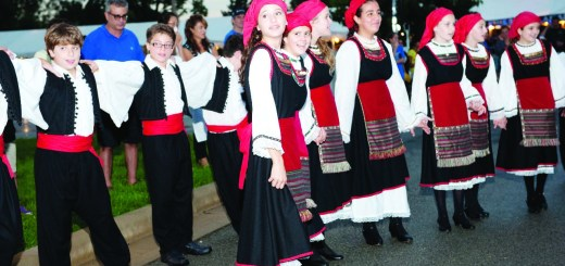 Cutline: Members of the Youth Holy Trinity Hellenic Dance Troupe perform.