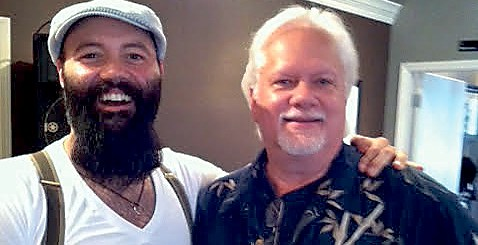 Rick Kingston (right) with Rev. Peyton, the leader of Rev. Peyton's Big Damn Band.