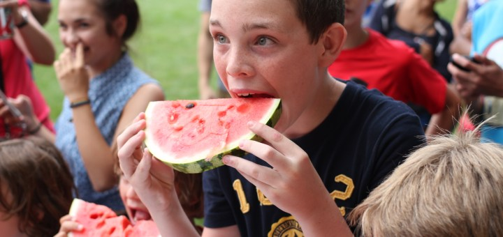 Children partake in the annual water- melon eating contest at Lions Park during the July 4th festivities last year. For more on what's happening in the park this year see Page 14. (Photo by Keith Shepherd)