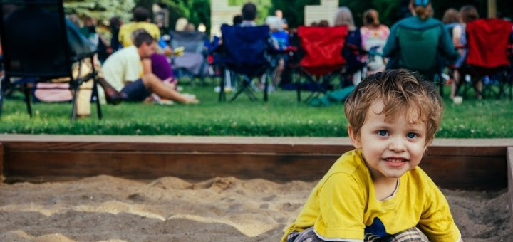Lucian Armstrong, 3, of Zionsville, plays in the sandbox during an outdoor jazz concert. (Photo by Julie Kennedy)