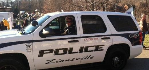 Former Zionsville police officer Wayde Knox drove through town during a parade last year. (Submitted photos)