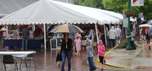 Visitors with open umbrellas were abundant during an afternoon rain shower.