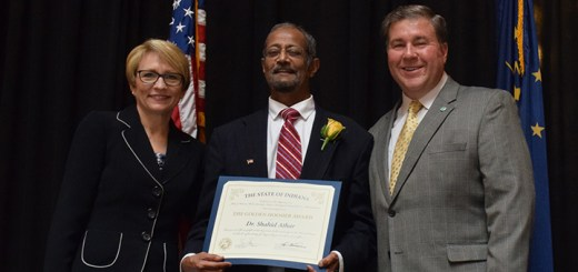 Dr. Shahid Athar, middle, accepts the Golden Hoosier Award from Indiana Lt. Gov. Sue Ellspermann, left, and Dr. John Wernert, secretary of the Indiana Family and Social Services Administrations. (submitted photo)