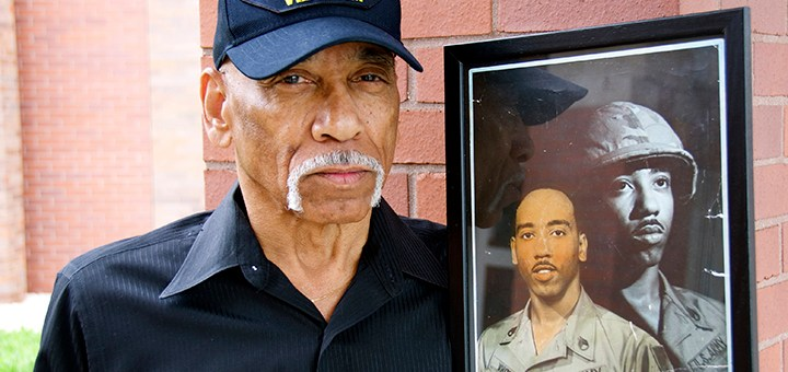 Vietnam War veteran Steve White displays a photo from his days in the U.S. Army. (Photo by Lisa Price)