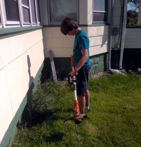 Will trying out the cordless trimmer around the front of the house.