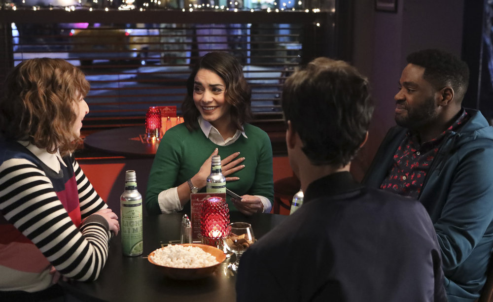 "POWERLESS -- ""Wayne or Lose"" Episode 102 -- Pictured: (l-r) Jennie Pierson as Wendy, Vanessa Hudgens as Emily, Ron Funches as Ron, Danny Puid as Teddy -- (Photo by: Evans Vestal Ward/NBC)"