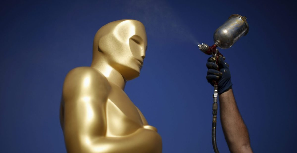 A worker spray paints an Oscar statue outside the Dolby Theatre as preparations continue for the 88th Academy Awards in Hollywood, Los Angeles, California February 25, 2016. The Oscars will be presented February 28, 2016. REUTERS/Lucy Nicholson      TPX IMAGES OF THE DAY      - RTX28N0C